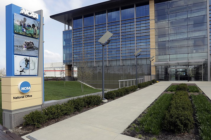"This is an April 25, 2018, file photo, showing NCAA headquarters in Indianapolis. The NCAA Board of Governors took the first step Tuesday, Oct. 29, 2019, toward allowing athletes to cash in on their fame, voting unanimously to clear the way for the amateur athletes to ""benefit from the use of their name, image and likeness."" The United States' largest governing body for college athletics realized that it ""must embrace change to provide the best possible experience for college athletes,"" the board said in a news release issued after the vote at Emory University in Atlanta. (Darron Cummings/AP, file)"