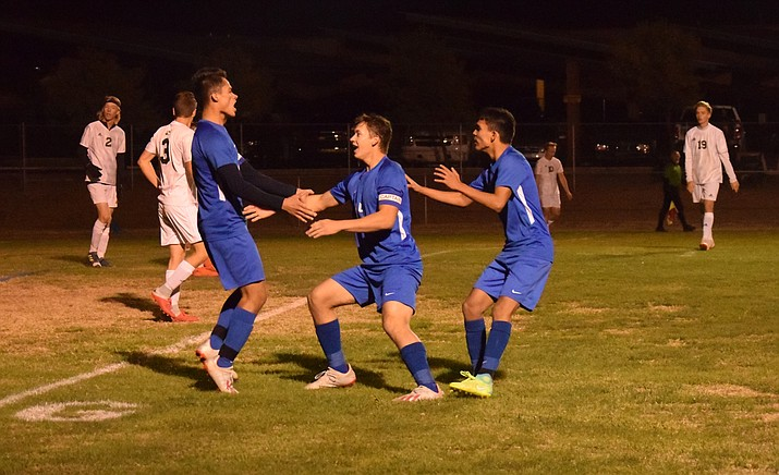 Camp Verde celebrates senior Manuel Interiano's game-winning goal in their 2-1 quarterfinal victory over Show Low on Wednesday night at home. VVN/James Kelley