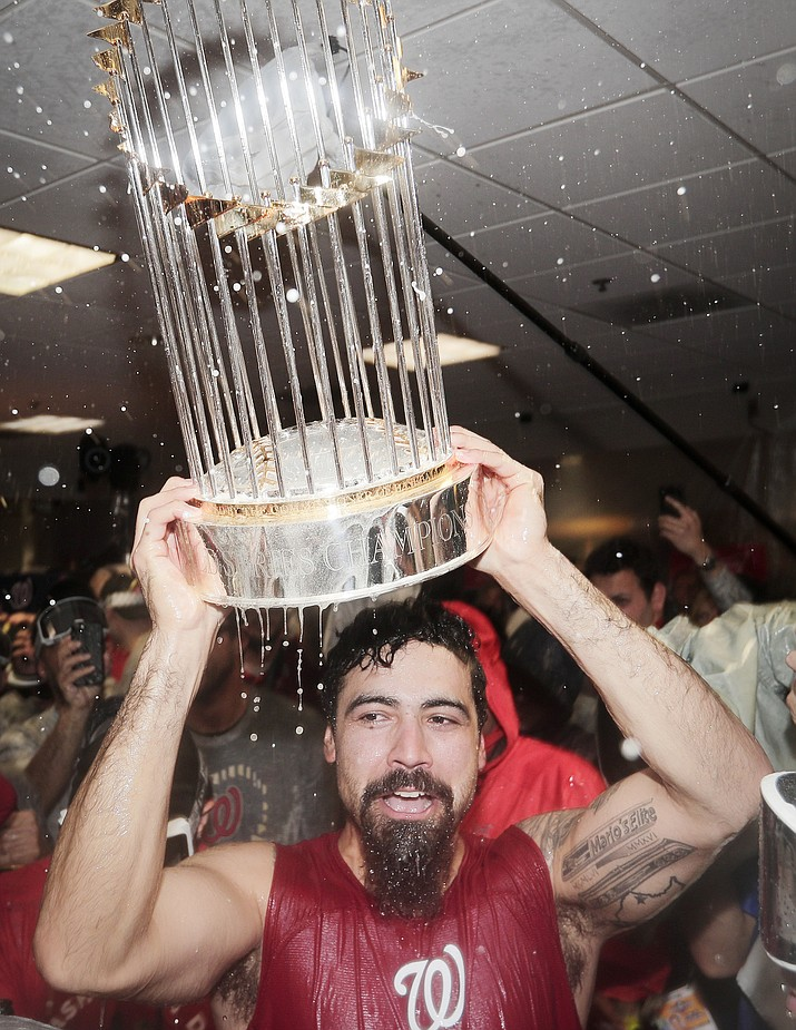 Washington Nationals third baseman Anthony Rendon celebrates with the trophy in the locker room after Game 7 of the baseball World Series against the Houston Astros Wednesday, Oct. 30, 2019, in Houston. The Nationals won 6-2 to win the series. (David J. Phillip/AP)