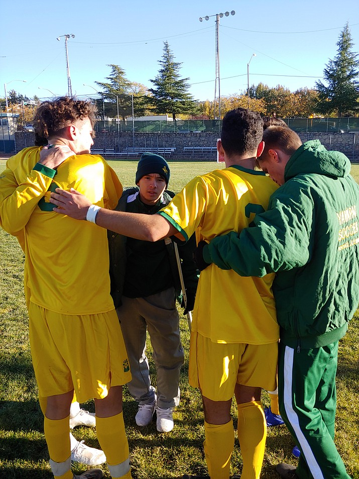 Yavapai College soccer players rally to console sophomore defender Gabriel Claudio (No. 5) after the Roughriders' 1-0 overtime loss to Pima in the NJCAA Division I, Region 1 semifinals Wednesday, Oct. 30, at Ken Lindley Field in Prescott. (Doug Cook/Courier)