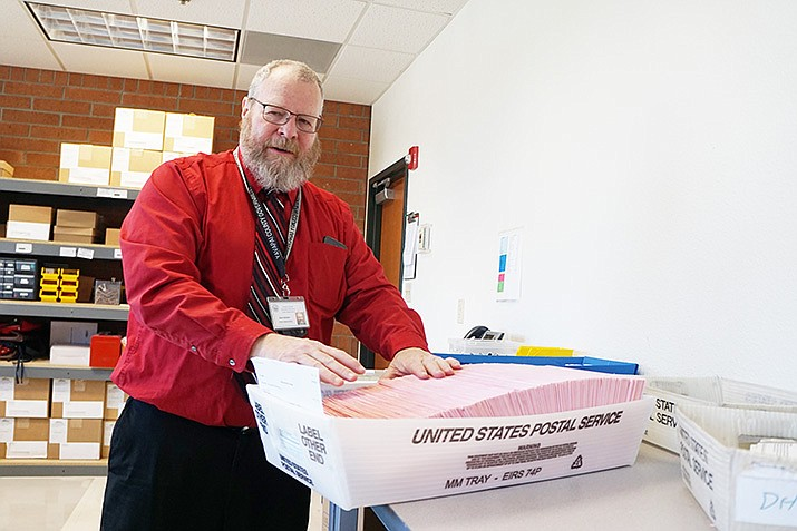 Matt Webber, voter registration specialist in the Yavapai County Recorder's Office, explains the process that takes place in the tabulation of votes. The deadline for ballots is approaching at 7 p.m. Tuesday for the Prescott City Council runoff election between Jim Lamerson and Steve Sischka. (Cindy Barks/Courier)