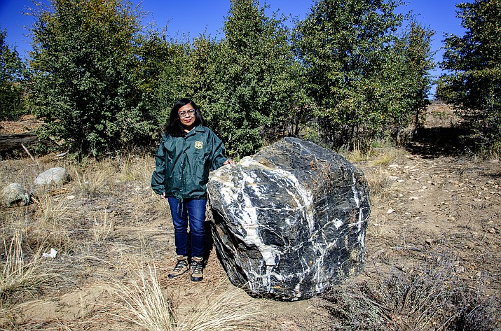 "A Prescott National Forest employee stands next to the ""Wizard Rock,"" which was returned to its original location after being taken in mid-October without the forest's permission. (Prescott National Forest/Courtesy)"