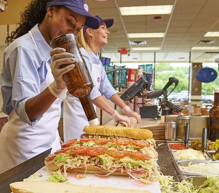One of Jersey Mike's Subs' most popular sandwiches is its Original Italian, as seen being made here by employees in this courtesy photo from Jersey Mike's. (Courtesy/Jersey Mike's Subs)