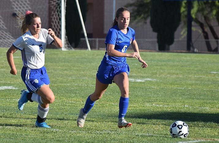 Camp Verde junior Bridgette Fitzgerald dribbles past a defender. VVN/James Kelley