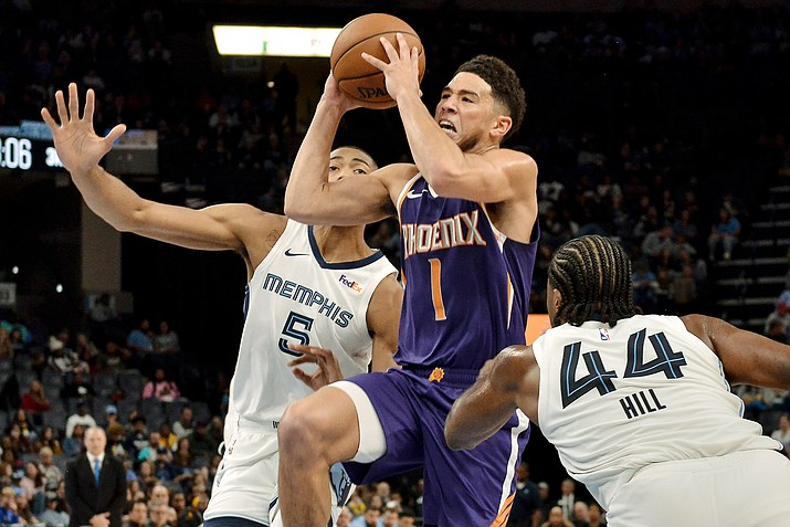 Phoenix Suns guard Devin Booker (1) shoots between Memphis Grizzlies forwards Bruno Caboclo (5) and Solomon Hill (44) in the second half of an NBA basketball game Saturday, Nov. 2, 2019, in Memphis. (Brandon Dill/AP)