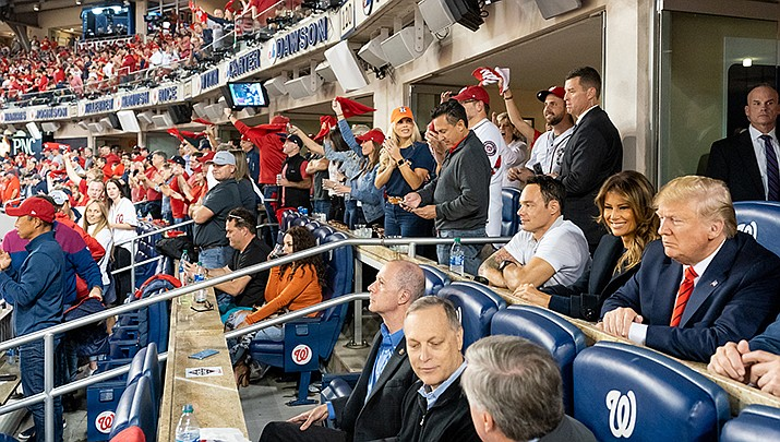 President Donald Trump and his entourage are shown at World Series Game 5 in Washington on Sunday, Oct. 27. On Saturday, Trump continued his sporting adventures by attending a UFC match at Madison Square Garden in New York. (White House photo)