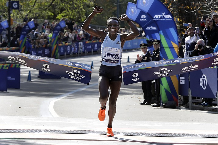 Joyciline Jepkosgei, of Kenya, crosses the finish line to win the Pro Women's Division of the New York City Marathon, in New York's Central Park, Sunday, Nov. 3, 2019. (Richard Drew/AP)