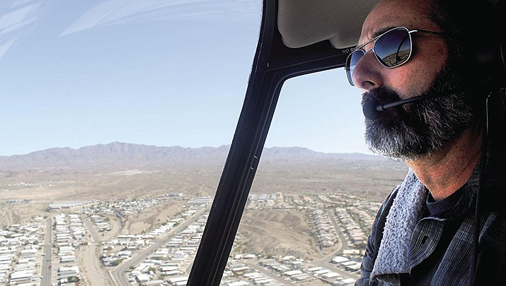 Havasu Helicopters owner and operator Michael Cuylber flies over Lake Havasu City on Friday, Nov. 1. (Photo by Michael Zogg/Today's News-Herald)