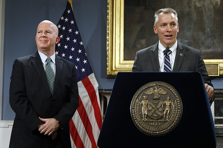New York City Police Commissioner James O'Neill, left, listens as his successor, Chief of Detectives Dermot Shea speaks at New York's City Hall, Monday, Nov. 4, 2019. New York City's police commissioner is retiring after three years in charge of the nation's largest police department, Mayor Bill de Blasio said Monday. (Richard Drew/AP)