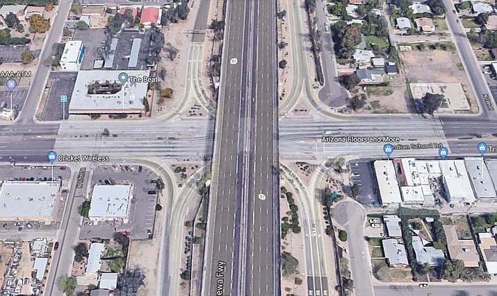 Pictured is the intersection of Highway 51 and Indian School Rd. in Phoenix. Authorities say an early morning crash Monday, Nov. 4, 2019, on Highway 51 was caused by a wrong-way driver. Tempe police said Monday that a sergeant and an officer suffered minor and non-life-threatening injuries in the 1:45 a.m. collision on State Route 51. (Google Maps screenshot)