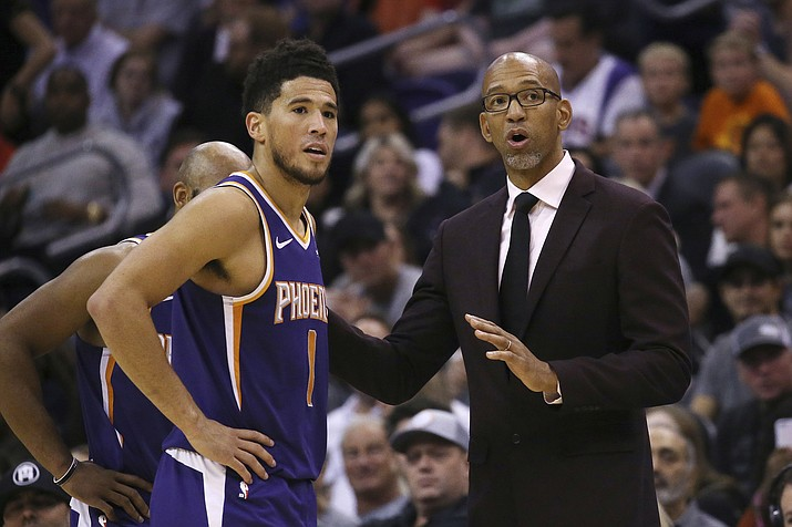 Phoenix Suns head coach Monty Williams, right, talks with Suns guard Devin Booker (1) during the second half of a basketball game against the LA Clippers Oct. 26 in Phoenix. The Suns defeated the Clippers 130-122. (AP Photo/Ross D. Franklin)