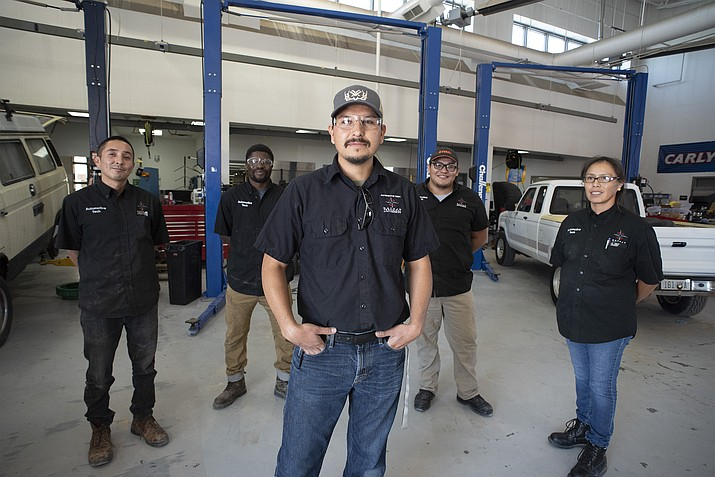 NTU's technical instructor of Automotive Technology Shanidiin Piechowski-Begay stands with his students in his Advanced Engine Performance course. NTU is pursuing NATEF accreditation for its Associate of Applied Science degree in Automotive Technology. (Photo courtesy/NTU)