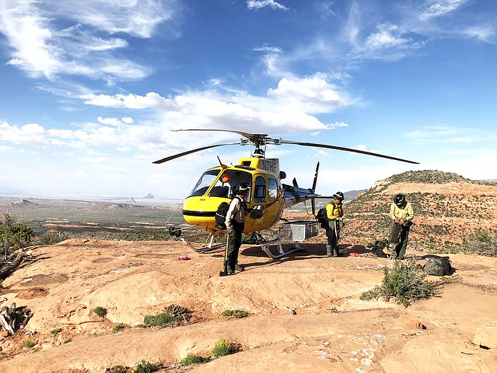 Navajo Helitack crewmembers load the helicopter after a hard day work at a local fire. (Photos courtesy of Navajo Helitack Program)