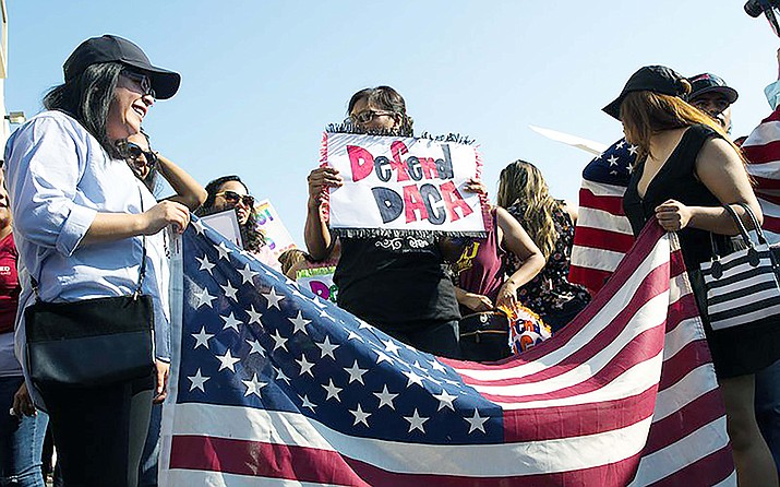 Protesters in this 2017 file photo to march toward the Immigration and Customs Enforcement field office in Phoenix after then-Attorney General Jeff Sessions called for an end to DACA. Courts blocked that move but the U.S. Supreme Court is set to hear arguments in the case Nov. 12. (Photo by Andrea Jaramillo/Cronkite News)