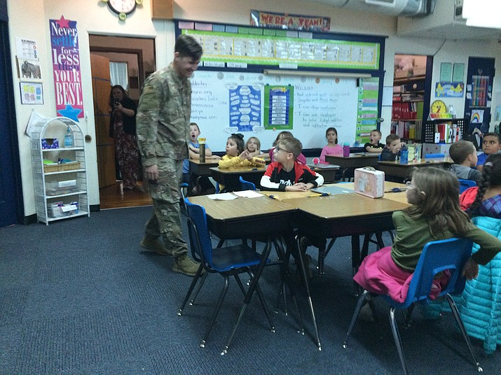 United States Air Force Staff Sgt. Ken Knobbe surprises eight-year-old son, Kameron, in his second-grade classroom at Lincoln Elementary School in Prescott. Knobbe is Prescott High alum. His wife, Annalise, is in the background. (Nanci Hutson/Courier)