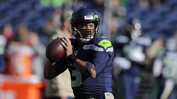 Seattle Seahawks quarterback Russell Wilson passes during warmups before an NFL football game against the Tampa Bay Buccaneers, Sunday, Nov. 3, 2019, in Seattle. (John Froschauer/AP)