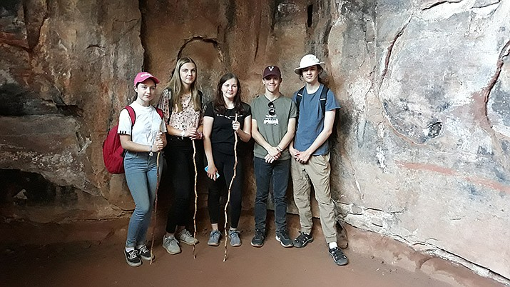 Shown at the cave paintings at Palatki Heritage Site are, from left, Emelie Lange, Paula Tessmer, Elisa Reinhold, Eric Ells and Jedidiah Ernst during a recent exchange between Prescott High School German students and Students from Prescott's sister city in Zeitz, Germany.(Eric Ellis/Courtesy)