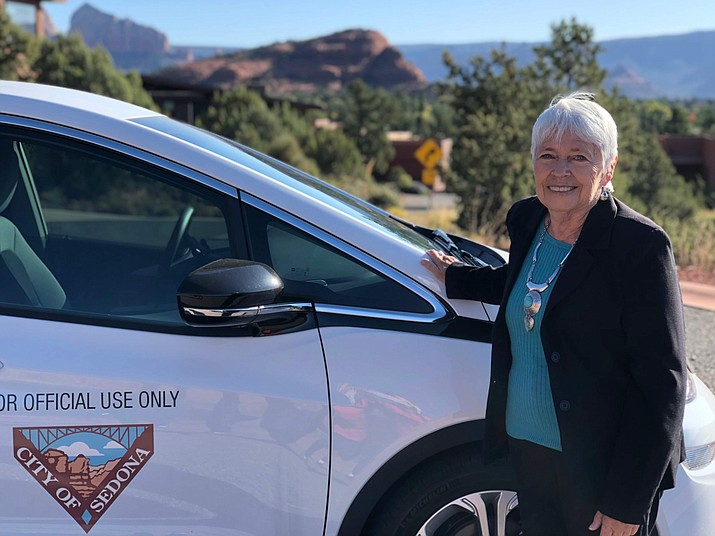 Sedona Mayor Sandy Moriarty recently showed off the city's newly arrived 2019 Chevy Bolt, the city's first all-electric vehicle, to be used by the city staff and occasionally by the mayor. Courtesy of City of Sedona.