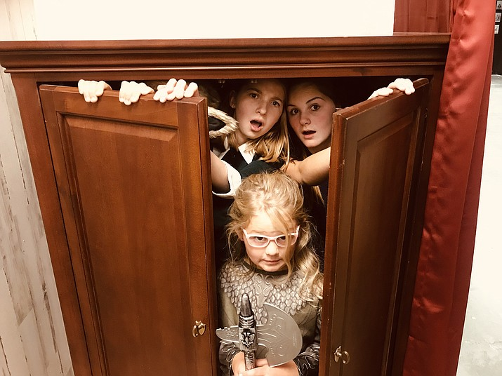 "The four Pevensie siblings coming out of the wardrobe that serves as a gateway to Narnia. One Stage Family Theatre is putting on two showings of ""Narnia the Musical""  at the Elks Theatre and Performing Arts Center Saturday, Nov. 16. (Tamee Niekamp/Courtesy)"