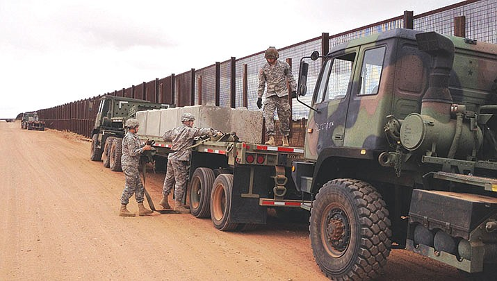 Arizona Army National Guard Soldiers assigned to the 2220th Transportation Company in Tucson, offload concrete barriers in Naco near the Arizona-Mexico border, March 1. (Photo by Cpl. Danielle Rodrigues Arizona National Guard Public Affairs https://www.dvidshub.net/image/1448723)