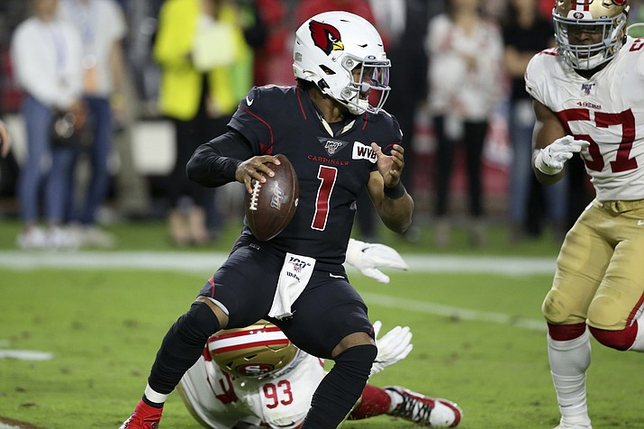 Arizona Cardinals quarterback Kyler Murray (1) avoids the hit of San Francisco 49ers defensive tackle D.J. Jones (93) during the first half of a game, Thursday, Oct. 31, 2019, in Glendale (Ross D. Franklin/AP)