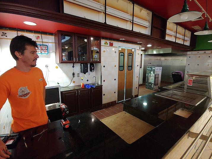 Thai Express co-owner Carlos Ramirez modifies the space where the former Chai's Thai had been operating in the Prescott Gateway Mall Food Court. The restaurant had been expected to open the weekend if Nov. 9 and 10. (Doug Cook/Courier)