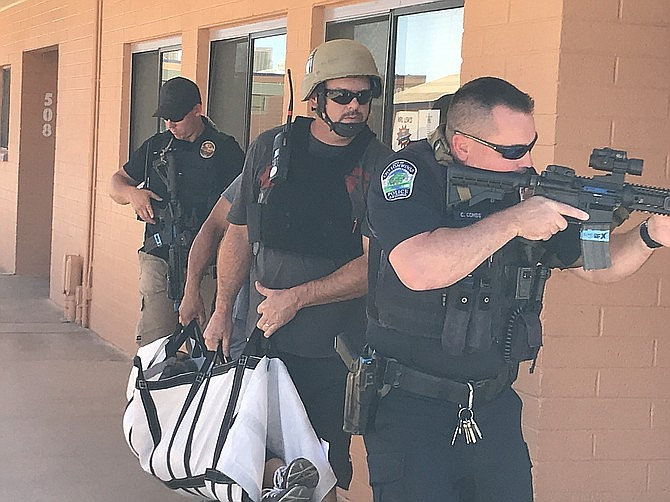 This police training drill might have involved some emergency medical services personnel. Three employees of Cottonwood Fire and EMS are members of the Verde Valley Regional SWAT Team, and a $6,400 Homeland Security grant will cover the purchase of ballistic vests and helmets for them. VVN file photo