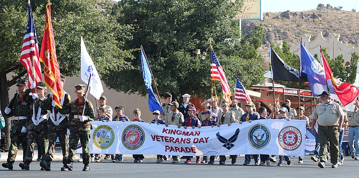 A military color guard leads the 2019 Veterans Day Parade in Kingman on Saturday, Nov. 9. (Photo by Travis Rains/Daily Miner)