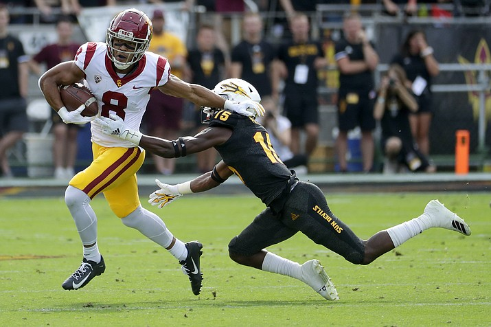 USC wide receiver Amon-Ra St. Brown (8) eludes the tackle of Arizona State safety Cam Phillips (15) during the first half of a game, Saturday, Nov. 9, 2019, in Tempe. (Matt York/AP)