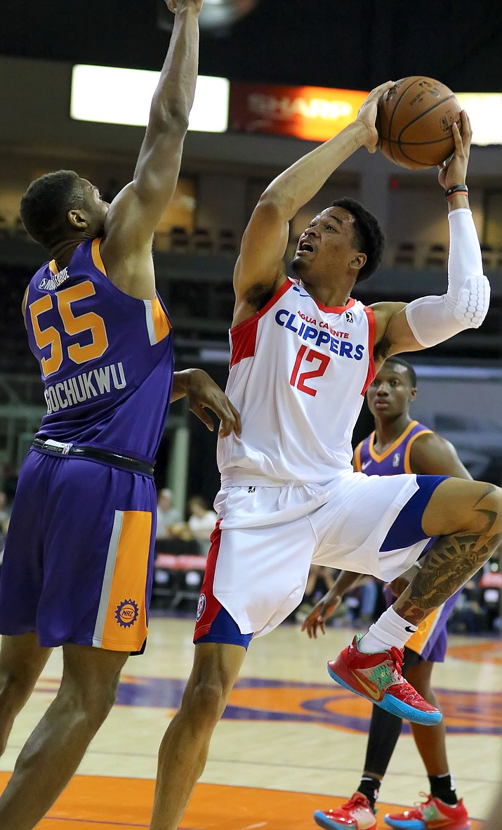 Agua Caliente Clippers forward James Palmer Jr. (12) tries to get a shot up over Northern Arizona Suns forward Stephen Ugochukwu (55) in a game on Saturday, Nov. 9, 2019, at the Findley Toyota Center in Prescott Valley. (Matt Hinshaw/Courtesy)