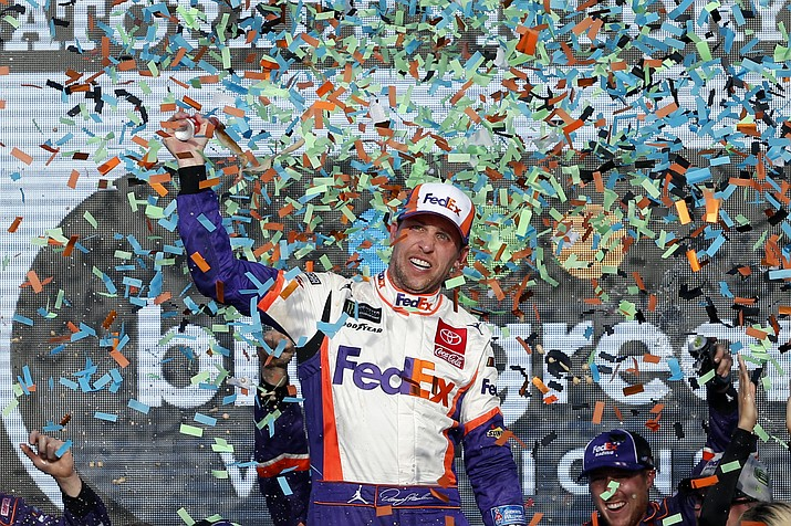 Denny Hamlin celebrates in Victory Lane after winning the NASCAR Cup Series auto race Sunday, Nov. 10, 2019, in Avondale, Ariz. (AP Photo/Ralph Freso)