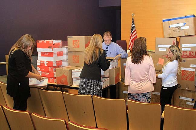 The Yavapai County Education Service Agency (YCESA) distributed 108 boxes of boys and girls coats to 27 district and charter schools throughout Yavapai County on Nov. 5. (Courtesy)
