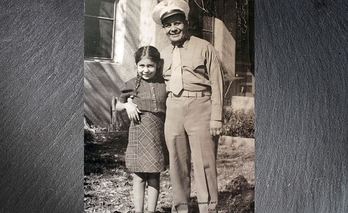 This file photo shows a photograph of Miguel Trujillo of Isleta Pueblo, N.M., and his daughter on display for an exhibit at the Indian Pueblo Cultural Center in Albuquerque, N.M. Trujillo fought in 1948 for the right of American Indians to vote in New Mexico after serving in World War II. (Indian Pueblo Cultural Center photo)