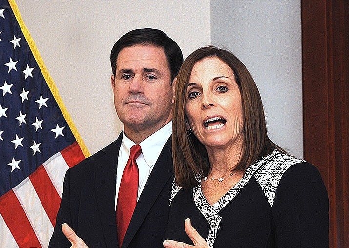 U.S. Sen. Martha McSally (R-Ariz.), shown with Arizona Gov. Doug Ducey, said Monday, Nov. 11, that ICE should given special consideration to veterans who are in the country illegally. (Howard Fischer/Capitol Media Services)