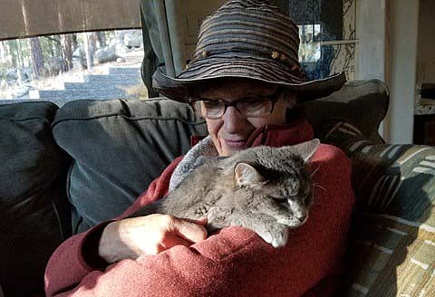 Consuelo, a wonderfully furry kitty, loves to cuddle and provides great comfort to Pearl, whether she needs it or not! (Robert Edwards/Courtesy)