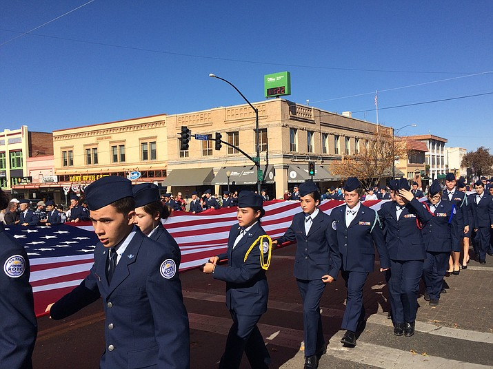 The Prescott High School JROTC carries an oversized American flag as part of the parade commemorations. (Nanci Hutson/Courier)