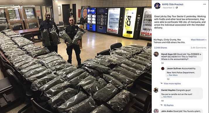 In this undated photo taken from the New York Police Department Facebook page, officers stand by what NYPD thought was marijuana when they confiscated in the Brooklyn borough of New York on Saturday, Nov. 2, 2019, at the 75th Precinct of the NYPD in New York. (New York Police Department via AP)
