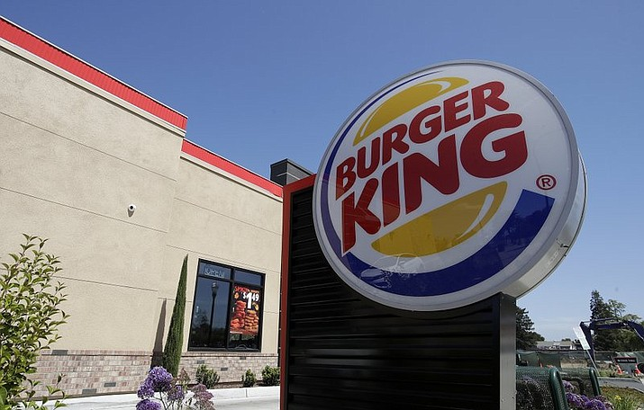 This April 25, 2019, file photo shows a Burger King in Redwood City, Calif. Burger King is introducing a plant-based burger in Europe. But it's not the Impossible Whopper that's been a hit with U.S. customers. Instead, a Dutch company called The Vegetarian Butcher will supply the new soy-based Rebel Whopper. It will go on sale Tuesday, Nov. 12, at 2,400 restaurants across Europe. (AP Photo/Jeff Chiu, File)