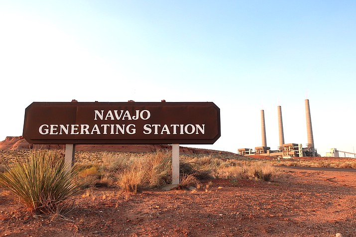 The coal-fired Navajo Generating Station near Page, Arizona will close before the year ends, upending the lives of hundreds of mostly Native American workers who mined coal, loaded it and played a part in producing electricity that powered the American Southwest. (AP Photo/Felicia Fonseca and Susan M. Bryan)