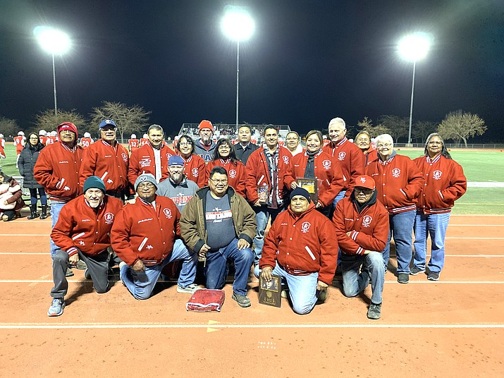 """Monument Valley High School inducted their 2019 Hall of Fame inductees Nov. 1, in Kayenta, Arizona. New inductees include Elvina Clark-Joe, Dallas Gilmore, Harlan Herder and the 1987-1988 Cross Country Team. New inductees pose with former Hall of Famers. Back row, from left: Harold Stanley, 2013 Robert Nash, 2013; Ed Tano, 2015; Michelle Jensen-Crawley, 2017; Brett Ritchhart, 2019 inductee; Gladys Yellowhair, 2013; Adrian Holiday, 2019 inductee; Dallas Gilmore, 2019 inductee; Charlotte Salt, 2016; Elvina Clark-Joe, 2019 inductee; Ollie Whaley, 2017; Pam Chapmen, 2015; Lucinda Nash, 2013; and Alicia Billie, 2015. Front row, from left: Ralph Farr, 2015; John """"Buck"""" Tenakhongva, 2017; Ryan Ritchhart, 2019 inductee; Darrell Shepperd, 2019 inductee; Harlan Herder, 2019 inductee and Anderson Holiday, 2015. (Submitted photo)"""