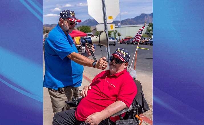 Gene Kirkham, standing, and Ken Conaway are shown during a parade of cars in Kingman. (Courtesy photo)