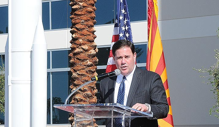 """Arizona Gov. Doug Ducey speaks at a recent event in Chandler. Ducey said Friday he won't take advantage of an offer by President Trump to allow Arizona to opt out of taking refugees, writing to U.S. Secretary of State Mike Pompeo that the state is consenting to """"initial refugee resettlement in Arizona'' as required by Trump's executive order. (Capitol Media Services file photo by Howard Fischer)"""