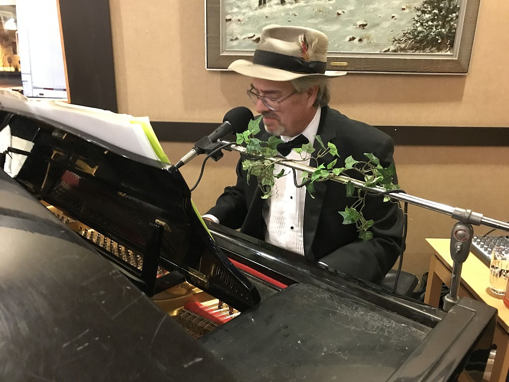 A man plays the piano for entertainment before dinner at the annual Prescott Area Habitat for Humanity Toolbelts & Tuxedos Gala on Saturday, Nov. 9, 2019, in Prescott. (Brian M. Bergner Jr./Courier)