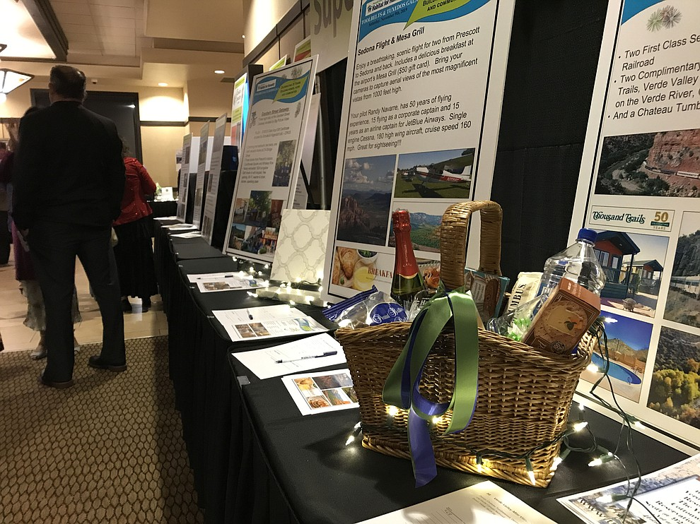 Items from the silent auction before dinner at the annual Prescott Area Habitat for Humanity Toolbelts & Tuxedos Gala on Saturday, Nov. 9, 2019, in Prescott. (Brian M. Bergner Jr./Courier)
