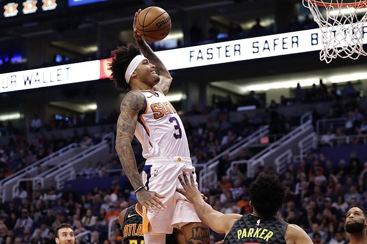 Phoenix Suns forward Kelly Oubre Jr. (3) dunks against the Atlanta Hawks during the second half of a game, Thursday, Nov. 14, 2019, in Phoenix. (Matt York/AP)