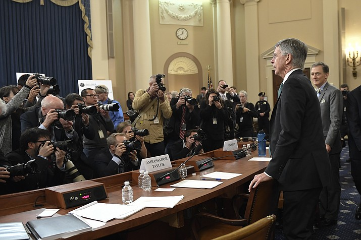 Top U.S. diplomat in Ukraine William Taylor, second from right, and career Foreign Service officer George Kent, right, return to testify following a recess of the House Intelligence Committee on Capitol Hill in Washington, Wednesday, Nov. 13, 2019, during the first public impeachment hearing of President Donald Trump's efforts to tie U.S. aid for Ukraine to investigations of his political opponents. (Susan Walsh/AP)