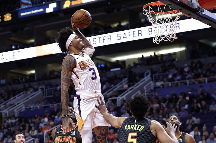 Phoenix Suns forward Kelly Oubre Jr. (3) dunks over Atlanta Hawks forward Jabari Parker (5) during the second half of an NBA basketball game Thursday, Nov. 14 in Phoenix. (Matt York/Associated Press)
