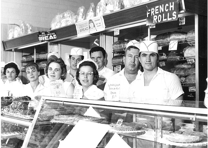 Russ Rusing is the gentleman in the back of the group by the bakery counter. (Yavapai College/Courtesy)