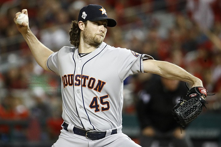 In this Oct. 27, 2019, photo, Houston Astros starting pitcher Gerrit Cole throws against the Washington Nationals during the first inning of Game 5 of the World Series in Washington. (Patrick Semansky/AP, file)