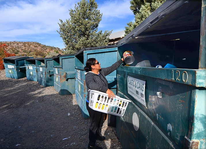 Eva Morales of Cornville brings her recycling to Sedona Recycling bins on Cornville Road on Saturday. The nonprofit's potential new contract with the county for the three sites is on a crowded consent agenda for Wednesday's Board of Supervisors meeting. VVN/Vyto Starinskas